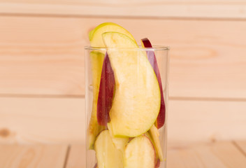 Apple slices in glass close up.