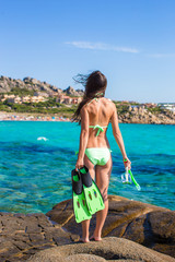 Young woman with snorkeling equipment ready for swimming