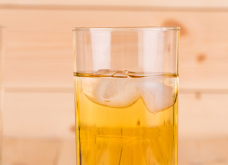 Close up of apple juice with ice.