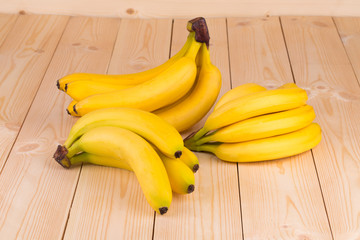 Bananas close up on wooden background.