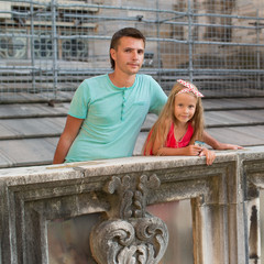 Adorable little girl with father on the rooftop of Duomo, Milan