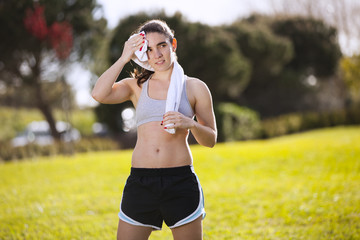Woman refreshing atfer running