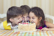 kids have fun eating birthday cake