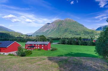 Norwegian farm under the mountains
