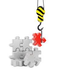 Crane hook and jigsaw puzzle