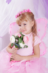Butterfly girl in wreath holding roses