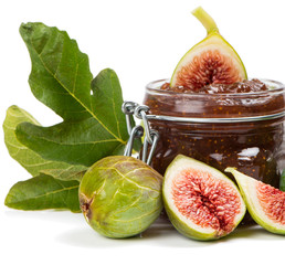 Fig jam in a preserving glass and fresh fruits with leaves