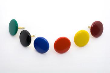 Macro Shot of A Collection of Six Colored Thumbtacks