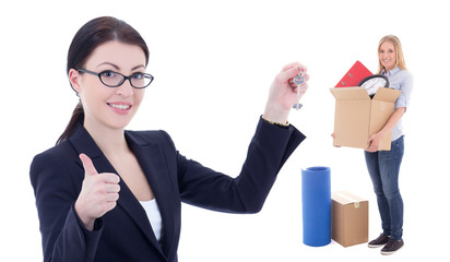 moving day concept - business woman with metal key and girl with