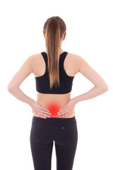 injury concept - young sporty woman with pain in her back isolat