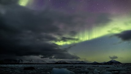 Northern lights behind the clouds