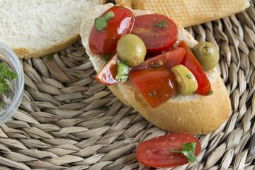Spanish food tapas. Toast with fresh tomato and basil