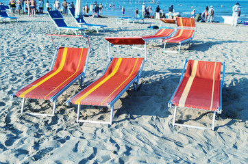 Colourful beach chairs and sun beds
