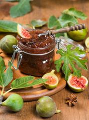 jar with fig jam and ripe figs