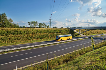 Corridor highway with yellow bus