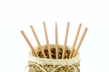 Pencils in a basket on isolated background