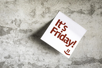 It's Friday on Paper Note on texture background