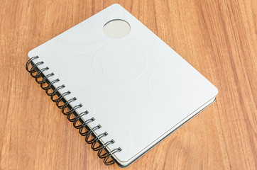 White diary on wood background