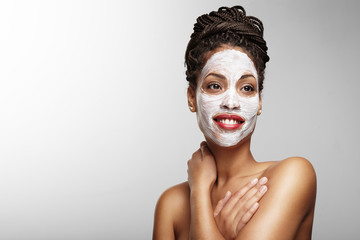 black woman with a cosmetic mask