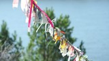 Pagan symbols colorful cloth on the rope for spirits poster