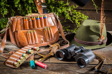 Bag, bullets and hat in a hunting lodge
