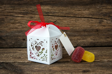 gift box with chocolates on a wooden background