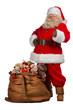 Santa Claus thumbs up near big bag full of gifts