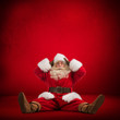 Santa Claus sitting on floor and looks frustrated