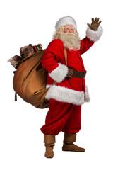 Santa Claus carrying big bag full of gifts