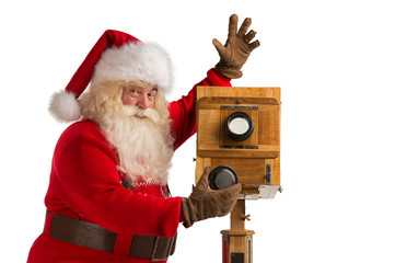 Santa Claus taking picture with old wooden camera