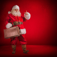 Santa Claus Standing With Travel Bag with Gits