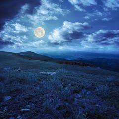 stones on the hillside of mountain range at night