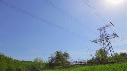 High voltage tower in green field