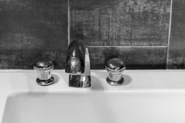 Closeup of  faucet in bathroom