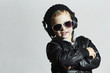 little deejay. funny smiling boy in sunglasses and headphones
