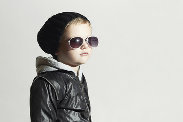child boy in sunglasses.Child in Black cap.Winter Kids fashion