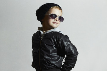 Fashionable child in sunglasses and Black cap.Smiling Little boy