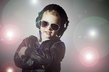 little DJ.funny boy in sunglasses and headphones.smiling child