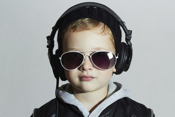 little DJ.funny boy in sunglasses and headphones.music deejay