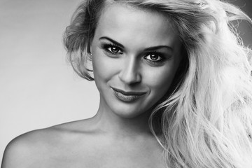 monochrome portrait of Beautiful smiling blond woman.happy girl