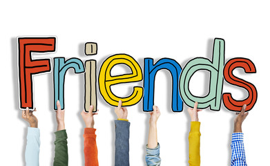 Multiethnic Group of Hands Holding Word Friends