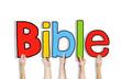 Obrazy na płótnie, fototapety, zdjęcia, fotoobrazy drukowane : Diverse Hands Holding the Word Bible