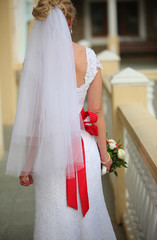 rear view of a beautiful bride with a festive bouquet of flowers