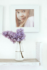 Bouquet of flowers and photo frame