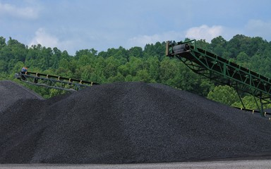 Two Large Piles of Coal