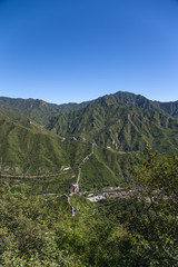 Mountain valley. Section of the Great Wall in the background