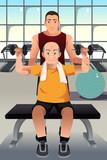 Personal trainer training an elderly man