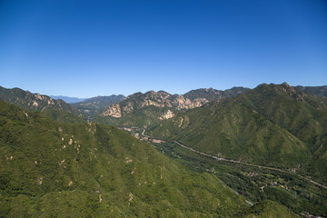 Mountain valley. In the background is the Great Wall of China