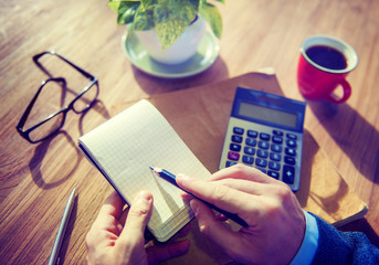 Hands of Businessman Working with Calculator