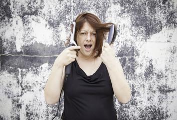 Woman combing hair salon
